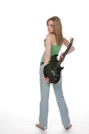 tight jeans: femme sexy en jeans serr�s et vert shirt noir avec guitare �lectrique