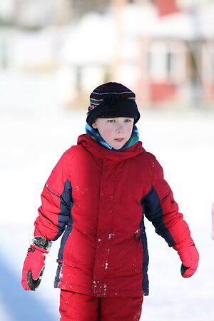 cute boy in red snowsuit and rosy red cheeks 版權商用圖片 - 3618928