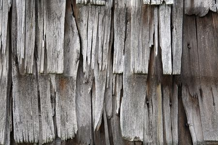 cedar shakes: close up of old, weathered, tattered wooden siding or shingles Stock Photo