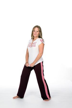 sweats: attractive young woman in black and pink workout gear Stock Photo