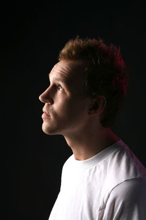 receding: profile of attractive man with receding hair and facial stubble