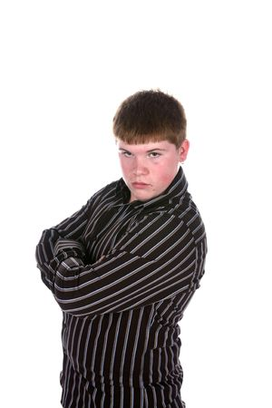 teen boy standing with arms crossed in a striped shirt