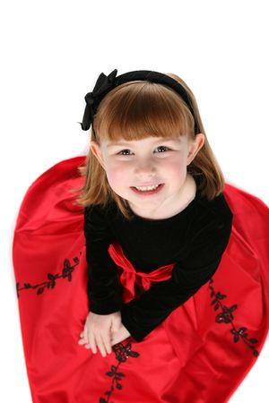 bow hair: cerca de la bonita ni�a de vacaciones vestido de rojo y negro cabello arco Foto de archivo