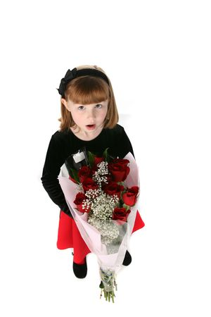 baby's: looking down on a cute young girl with red roses Stock Photo