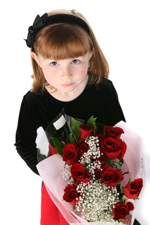 looking down on a pretty little girl with a bouquet of red roses photo