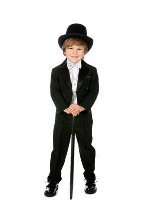 young boy grinning and wearing his black tuxedo photo
