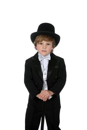cute young boy in black tuxedo and top hat photo