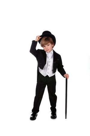 young boy in black tuxedo tipping his top hat