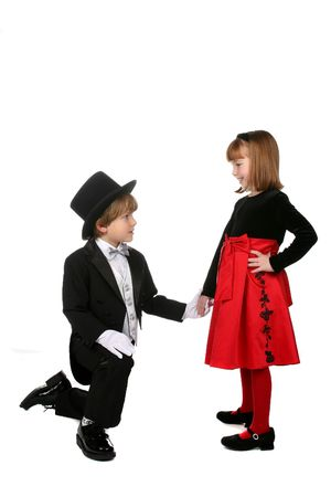 children in formal clothing mimicing adult proposal behavior photo