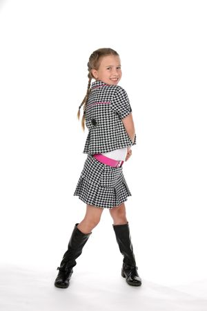 cute pre teen girl in black and white checkered stylish outfit Stock Photo