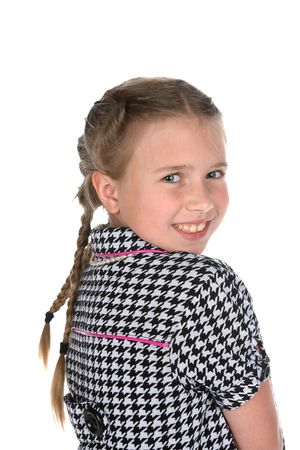 head and shoulders portrait of cute girl in black and white checks and braids