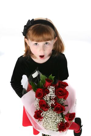 mouth close up: cute young girl in black and red holiday dress with roses