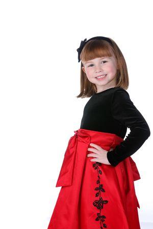 bow hair: linda chica en rojo y negro vestido de fiesta con secador de proa Foto de archivo