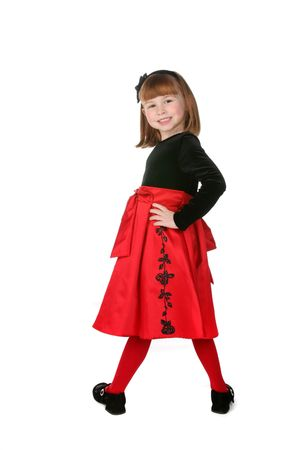 velvet dress: pretty little girl wearing black and red Christmas or Valentines holiday dress