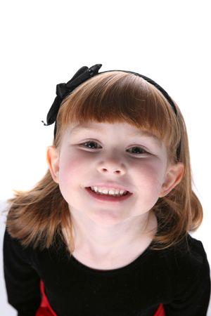 bow hair: cerca de la bonita ni�a de pelo negro con arco y mejillas cute