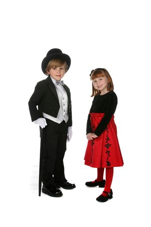 cute boy and girl in formal holiday clothing photo