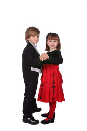 cute young children dancing together in formal holiday clothing photo
