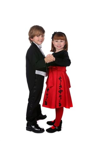 cute boy and girl in formal holiday clothing dancing together photo
