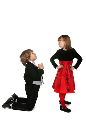 cute children in formal clothing mimicing adult proposal behavior