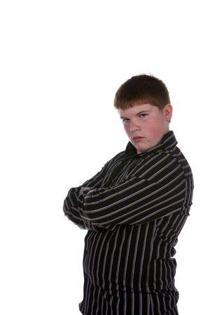 overgewicht tiener jongen met armen gekruist en een oorbel Stockfoto
