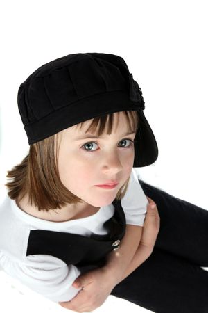arms crossed funky little girl in black hat  Stock Photo