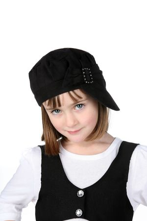 cute girl in black and white clothing with big eyes and sideways hat