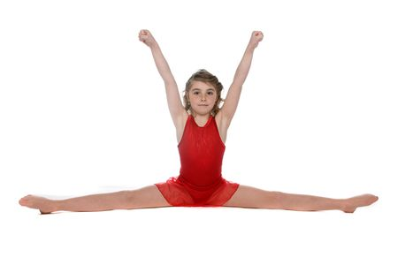 arms above head: cute young girl doing a split with her arms above her head
