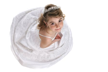 looking down on a cute girl in tiara and white formal gown