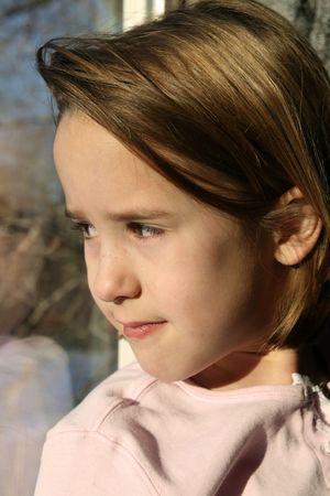 natural light portrait of pretty young girl at the window Archivio Fotografico