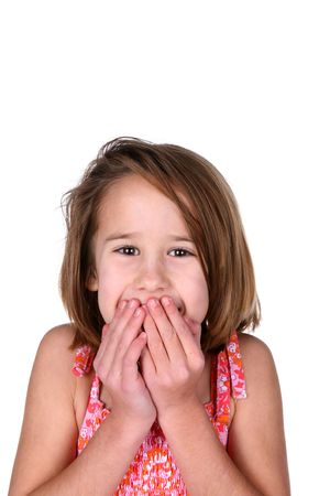 cute girl with her hands covering her mouth as if in surprise Stock Photo