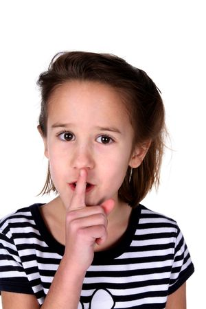 young girl with her finger over her mouth asking you to be quiet Stock Photo
