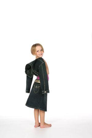 cute girl in dark denim skirt with jacket slung over her shoulder