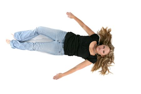 young woman on the floor on her back with arms out