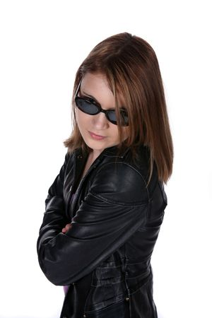 defiant: pretty teen in black leather jacket and sunglasses