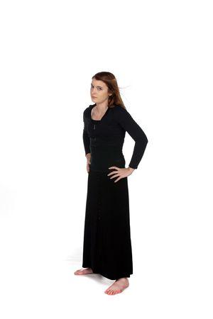 teenage girl in long black dress portraying an attitude photo