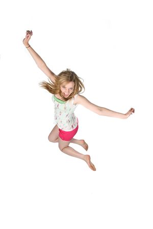 attractive young woman jumping for joy as seen from above Фото со стока