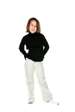 cute young girl in light pants and dark shirt photo