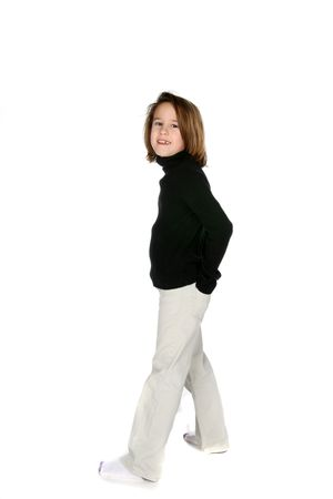 cute girl standing with hands in her back pockets photo