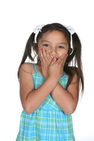 olive skin: girl covering her mouth with her hands as if trying to keep a secret Stock Photo