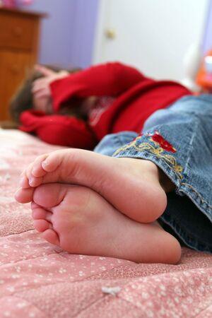selective focus of little girls bare feet