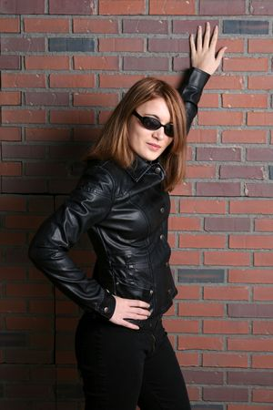 preety and tough looking teen in black leather and jeans photo