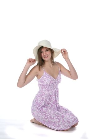 pretty teen in casual purple dress and hat Stock Photo