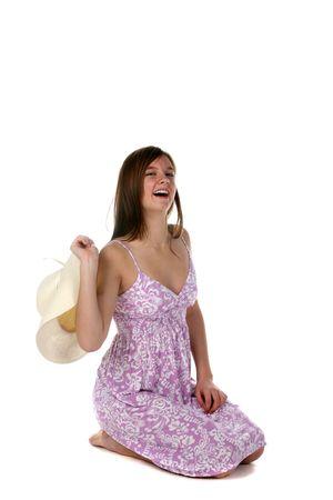 sundress: pretty kneeling teenage girl in purple sundress
