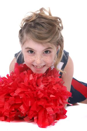 close up of cheerleader girls face and red pompom photo