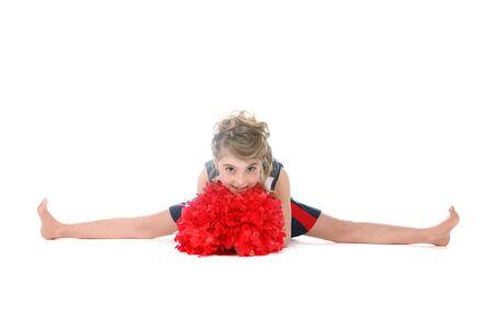 bare girl: cheerleader girl doing a split and holding pompom Stock Photo