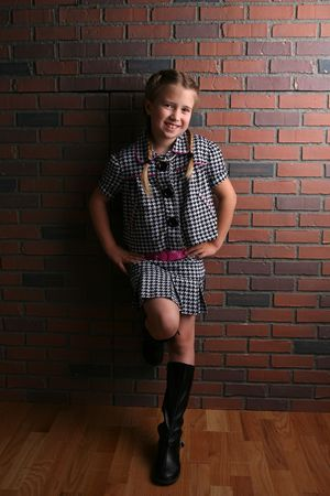 pretty girl against brick wall in natural light Stock Photo - 5239584