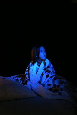 girl wrapped up in handmade quilt photo