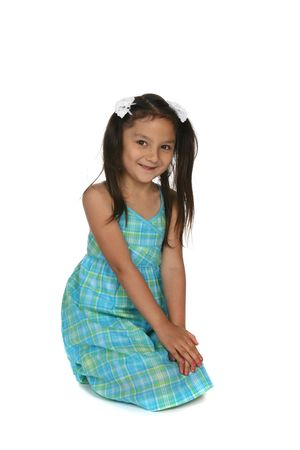 pretty young girl in blue plaid dress with hands on knees Stock Photo - 5802727