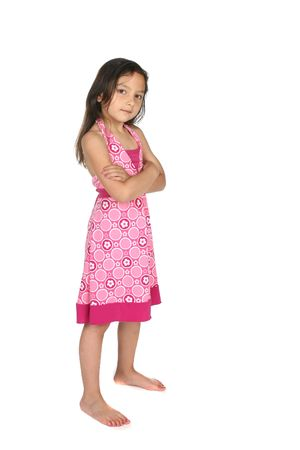 feet crossed: cute girl, looking stubborn and standing with arms crossed