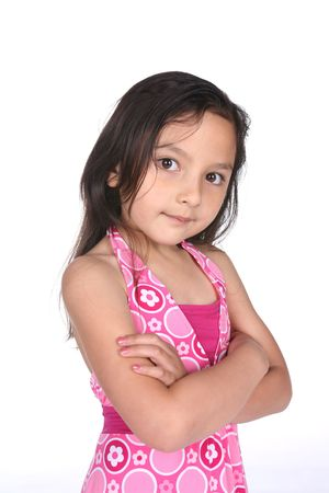 girl with arms crossed and stubborn look on her face photo